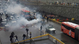 Officer killed, police stations STORMED by protesters amid anti-fuel hike rallies in Iran