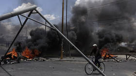 'He died in my hands': 3 pro-Morales demonstrators killed in clashes with Bolivia's police & soldiers near barricaded fuel plant