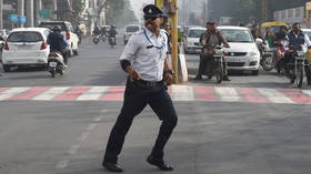 Oh how the mighty have fallen? India's 'dancing cop' filmed slapping and kicking auto-rickshaw (VIDEO)