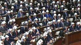 Safety first: Japanese MPs practice putting on foldable helmets in earthquake drill (VIDEO)