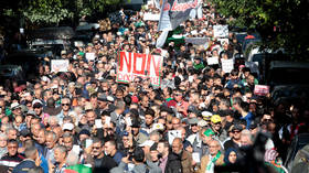 Thousands of Algerians march to demand cancellation of presidential election
