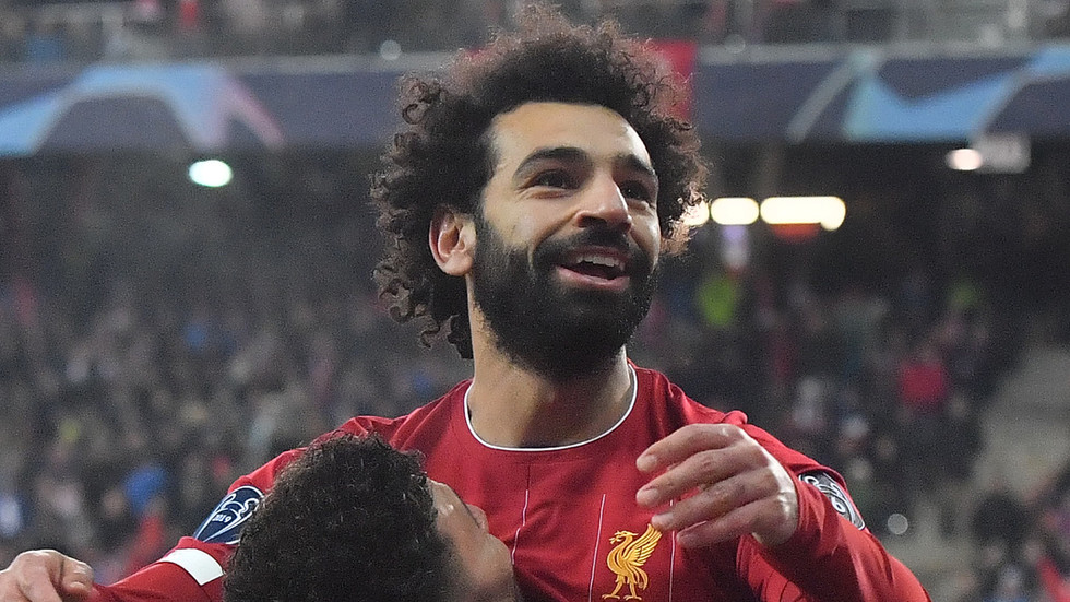 Egyptian King! Salah scores 200th goal for club & country from IMPOSSIBLE angle as Liverpool advance in UCL