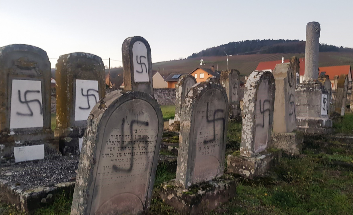 Dozens of swastikas scrawled on tombs at Jewish cemetery