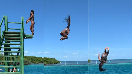 Making a splash: Gymnastics legend Simone Biles pulls off jaw-dropping dismount into the sea (VIDEO)