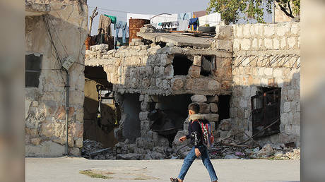 A child walks past an area that has been targeted by the terrorist groups less than 200 meters away. Khalidiyah, west Aleppo. © Vanessa Beeley