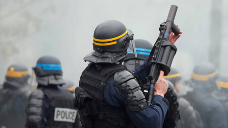 Police fire 'tear gas' at marchers in Nantes, France as nationwide strike against Macron's pension reforms rages (VIDEOS)