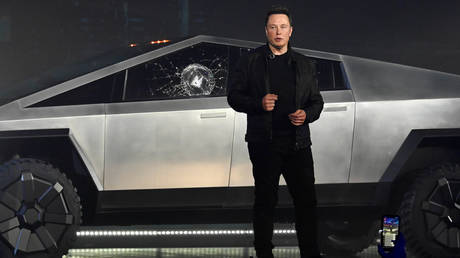 Elon Musk whacks traffic cone while driving Tesla Cybertruck after night out (VIDEO)