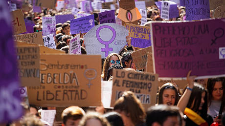 People take part in a protest during a nationwide feminist strike on International Women's Day in Madrid © REUTERS/Juan Medina