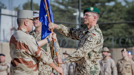 FILE PHOTO: Peter Mirow, Bundeswehr General, receives the troop flag of the EU training mission EUTM MLI from the French General Daniel Grammatico, in Bamako, Mali, on November 12, 2018.