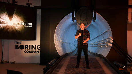 Elon Musk unveils a test tunnel of a proposed underground transportation network across Los Angeles County, in Hawthorne, California, U.S. December 18, 2018.