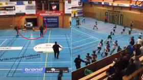 'A miracle no one was hurt': Handball players flee as CAR crashes through gym wall during game (VIDEO)