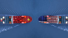 China to waive trade war tariffs for some US soybean & pork imports