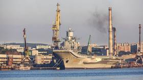 Russian aircraft carrier Admiral Kuznetsov seen covered in smoke in FIRST VIDEO