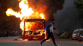 Protesters TORCH buses and clash with police in Delhi as Indian citizenship bill sparks street violence (PHOTOS/VIDEOS)