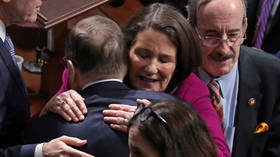 We won't forget: Democrats cheer, Republicans jeer after Trump impeachment vote
