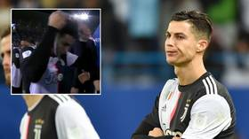 Crissed off: Dejected Cristiano Ronaldo removes loser's medal immediately after his incredible run of victories in finals ends