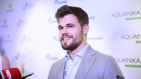 Norwegian chess king Magnus Carlsen claims World Blitz title in Moscow