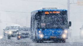 CHILLING VIDEO captures snow-covered passengers traveling on Russian bus with broken vent window