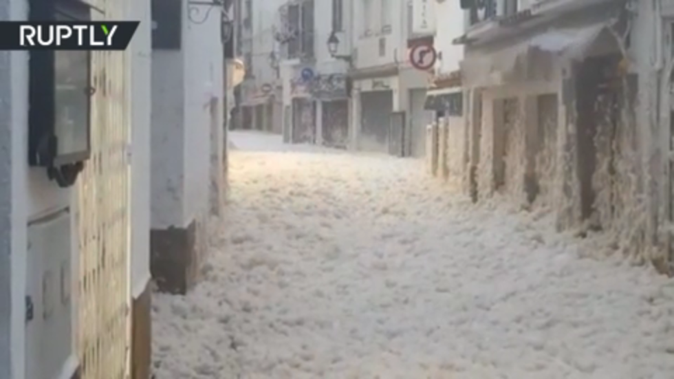 Sea foam blankets parts of Catalonia as GIGANTIC waves batter the Balearic...