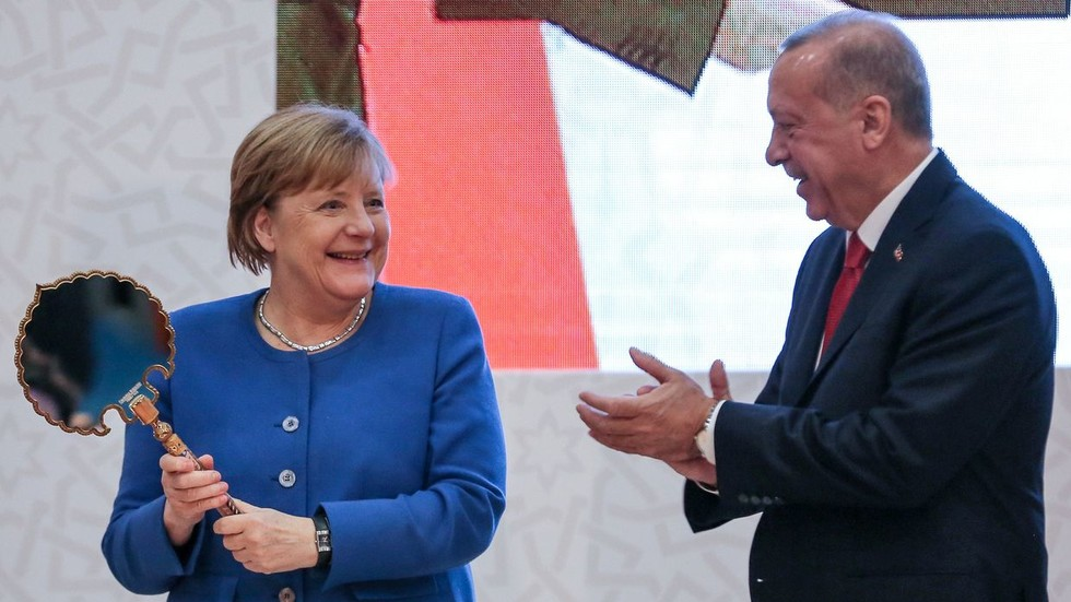 Merkel's Turkish delights: Erdogan showers German chancellor with gifts as the two meet in Istanbul (PHOTOS)