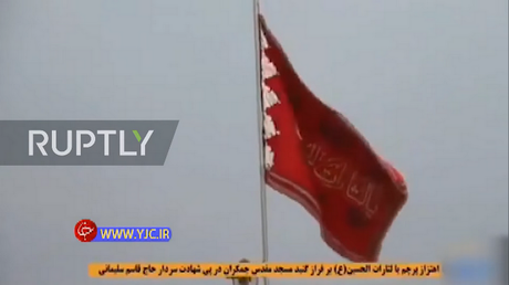 Iran hoists blood-red 'flag of revenge' in holy city of Qom as thousands mourn Soleimani across the region (VIDEOS)