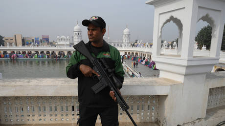 FILE PHOTO: A security personnel stands guard at Nankana Sahib