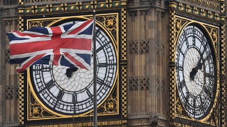 A union flag flies in front of the Great Clock of the Elizabeth Tower, more commonly referred to as 'Big Ben' © AFP / Justin Tallis