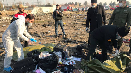 Passengers' belongings are seen after the Ukraine International Airlines plane crashed after take-off from Iran's Imam Khomeini airport, on the outskirts of Tehran, Iran January 8, 2020.