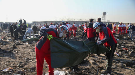 Red Crescent workers check plastic bags at the site where the Ukraine International Airlines plane crashed after take-off from Iran's Imam Khomeini airport, on the outskirts of Tehran, Iran January 8, 2020.