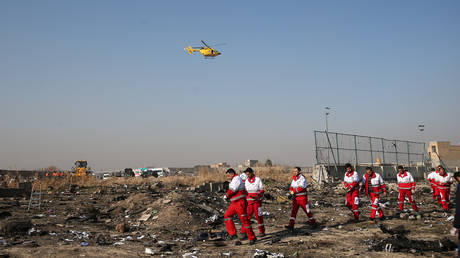 Rescue team works among debris of a plane that crashed after take-off from Iran's Imam Khomeini airport