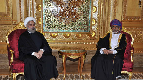 FILE PHOTO: Oman's Sultan Qaboos bin Said (R) meets with Iran's President Hassan Rouhani in Muscat, March 12, 2014