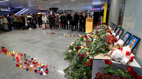 FILE PHOTO: Flowers and candles are seen in front of a memorial to the Ukrainian jet flight crew at the Boryspil International airport outside Kiev, Ukraine January 8, 2020.