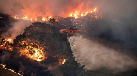 FILE PHOTO: A bushfire near Bairnsdale in Victoria's East Gippsland region © AFP