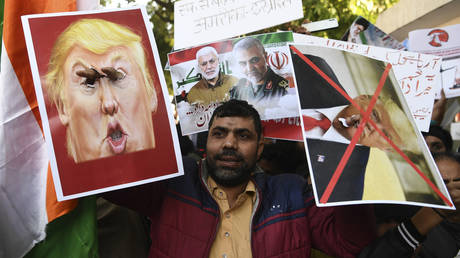 A demonstrator protesting the US drone strike that killed top Iranian General Qassem Soleimani in Iraq, at a rally in New Delhi on January 12, 2020. ©  AFP / Sajjad Hussain