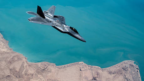 A U.S. F-22 Raptor, based out of Al Udeid Base in Doha, Qatar, receives fuel from a 28th Expeditionary Air Refuelling Squadron KC-135 Stratotanker during a combat air patrol mission over an undisclosed location in Southwest Asia © Reuters / U.S. Air Force / Handout / Russ Scalf