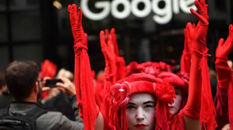 "Extinction Rebellion activists block the entrance to Google UK headquarters in London, demanding that it ""stop funding climate deniers"" on YouTube. © Global Look Press / ZUMA Press / Guilhem Baker"