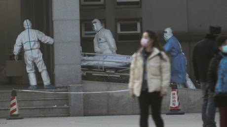 Medical staff transfer a patient at the Jinyintan hospital in Wuhan, January 20, 2020.
