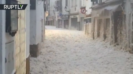 Sea foam blankets parts of Catalonia as GIGANTIC waves batter the Balearic Islands (VIDEOS)