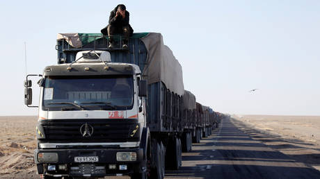 FILE PHOTO A truck convoy near the border with China in the Gobi Desert, Mongolia. October 2017. © Reuters / B. Rentsendorj