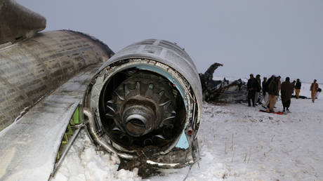 The wreckage of an airplane is seen after a crash in Deh Yak district of Ghazni province, Afghanistan.