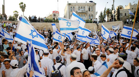 "FILE PHOTO. Jewish youth participate in a march marking ""Jerusalem Day"" in Jerusalem's Old City."