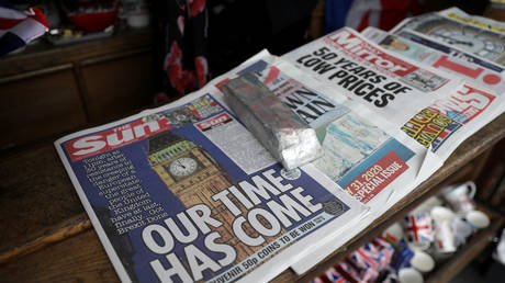 Newspapers and other souvenirs at a store near Parliament Square in London on Friday. © REUTERS/Simon Dawson