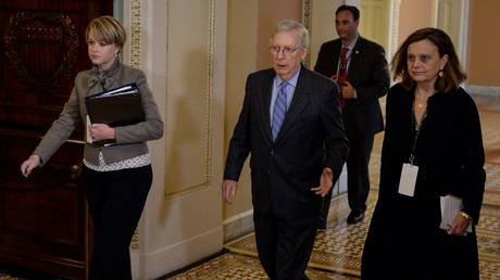 Senate Majority Leader Mitch McConnell (R-KY) walks to the Senate floor after a brief recess during the US President Donald Trump's Senate impeachment trial in Washington, January 31, 2020.