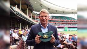 Australia's cricketing 'King of Spin' Shane Warne sells prized Baggy Green cap for bushfire victims