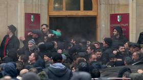 MPs call on Abkhazia's president to step down after opposition protesters STORM government