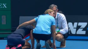 'Never experienced anything like it': Australian Open chiefs slammed as Slovenian star COLLAPSES on court amid bushfire smoke