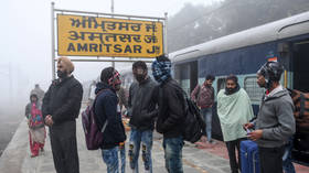 Dozens injured in India as passenger & cargo trains COLLIDE due to thick fog (PHOTOS)