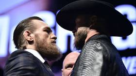 Conor McGregor comes in at his heaviest ever UFC weight while gaunt Cerrone also hits the mark to make bout official (VIDEO)