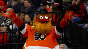 'He lunged over & punched my son!' Father recalls moment Philadelphia Flyers mascot allegedly assaulted 13yo fan
