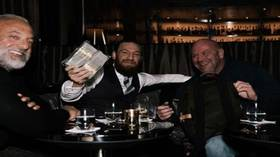 Conor cashes in: McGregor laughs as UFC boss Dana White hands him $50K IN CASH over whiskies to celebrate Cerrone win